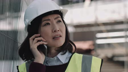 Architect speaking on phone on construction site