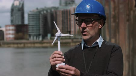 Engineer working on a Wind Turbine project at river bank