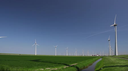 környezeti : Wind Turbine with blue sky and grass field.