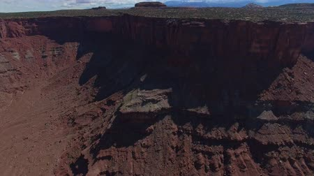shadows : United States - Flying Over Vast Canyon Revealing Rim and Distant Mountains Stock Footage