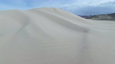 powerful : United States - Aerial view - lying Towards Epic Sand Dune Mountain Stock Footage