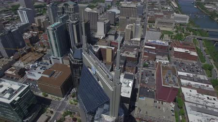 urban birds : Nashville, TN: Aerial Bat Building and Downtown buildings near Cumberland River Stock Footage