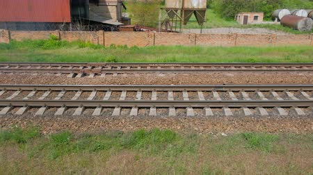 crosstie : Close View Of Railroad Track Moving At High Speed. Camera moves along the railway.
