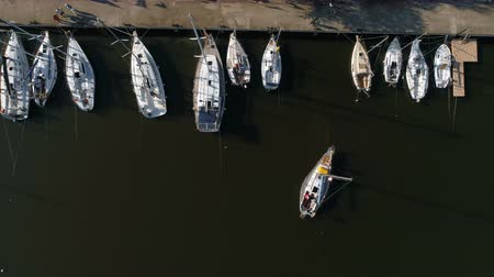 Aerial top view of a sailing yacht regatta. Flying over boats. 4k video