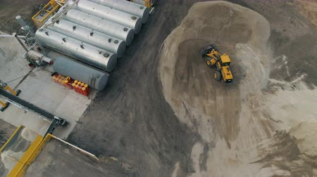 tarmac : Asphalt-Concrete Plant With Running Bulldozer. Aerial View. The plant construction