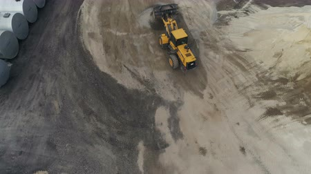 crawler : Asphalt-Concrete Plant With Running Bulldozer. Aerial View. The plant construction