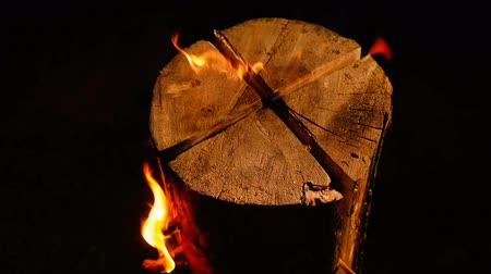 костра : Swedish or finnish log candle. Fire burning at night