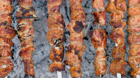 shish : Description: Grilling marinated shashlik (skewered meat) on a grill. Hot birch coal. Fresh juicy meat. Healthy food. Holidays BBQ. Stock Footage
