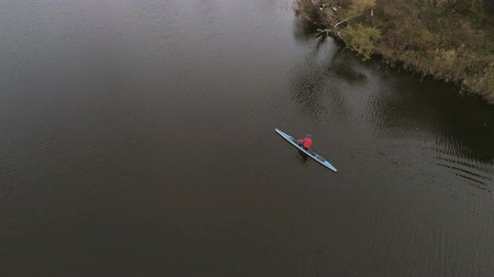 Aerial view Of Woman Kayaking In The River. Drone 4k footage of girl kayacking in the lake. Stok Video