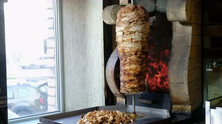 tripod shot : Large Doner Skewer Spinning In A Local Restaurant. Cooking shawarma