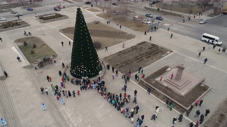 Central Square of City, The opening of the Christmas tree. New Year Decoration. Aerial 4K Footages