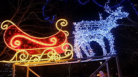 toboggan : Christmas Deer with sledge. New Year, Night Decor Atmosphere