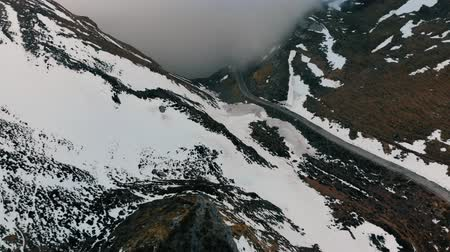 Road from the air of a snowy mountain pass Stok Video
