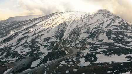 Aerial shot of a snowy mountain with ski resort