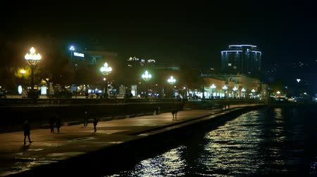 refocus : People at night walk along the promenade of the black sea in Crimea Stock Footage