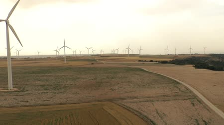 conservado : Flight through a field of wind turbines Stock Footage
