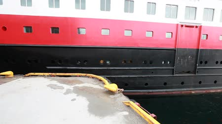 Big Norwegian passenger ferry does mooring operations with different angles of view
