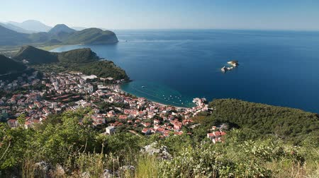 Черногория : Panorama of Petrovac resort town on the coast of Adriatic Sea, Montenegro Стоковые видеозаписи