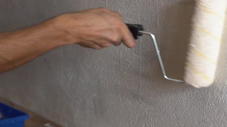 slowing : painting walls with a roller Stock Footage