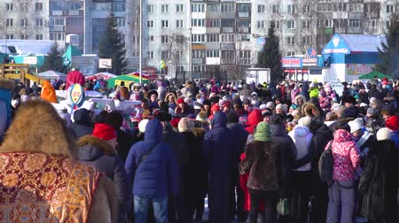 ice skating : Russia, Novokuznetsk - 18.02.2018: a crowd of people on holiday in the winter