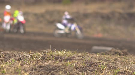 racers : Motocross driver in action accelerating the motorbike