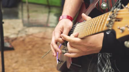 The guitarist plays on the street