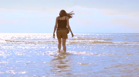 young girl goes to sea Stock Footage