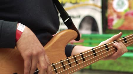 Musician plays bass guitar