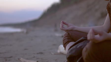 girl meditating by the sea
