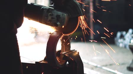 sawing the iron sparks