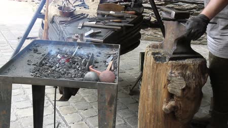 forging sword : Blacksmith. Medieval tradition of making armor and swords at the forge.
