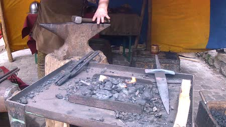 forging sword : Blacksmith. Medieval tradition of making armor and swords at the forge. Medieval Festival 2015 - Vianden Luxembourg.