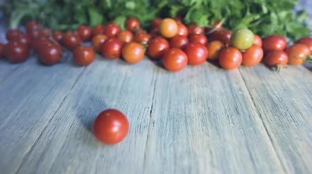 rustik : Cherry Tomatoes organic food ingredients on wooden rustic table background trendy style Stok Video
