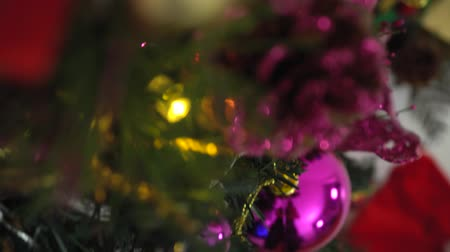 feliz natal : Greeting Season concept.Dolly of ornaments on a Christmas tree with decorative light and falling snow in 4k (UHD)