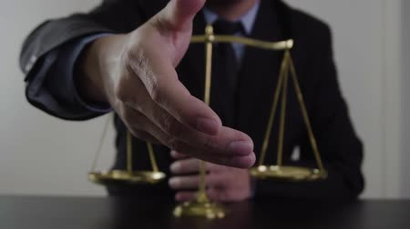 convidar : justice and law concept.Male lawyer in the office with brass scale on wooden table
