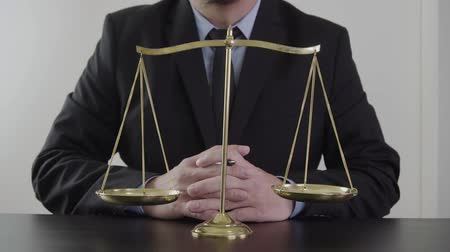 legal : justice and law concept.Male lawyer in the office with brass scale on wooden table