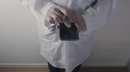 Doctor or Pharmacist working with smartphone in hospital