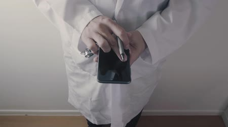 physician : Doctor or Pharmacist working with smartphone in hospital