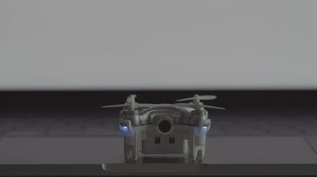 spying : Futuristic transportation concept.Micro drone take off from laptop computer Stock Footage