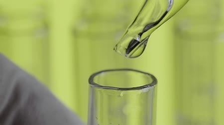 water drop : Close up of laboratory scientist hand working with a pipette Stock Footage