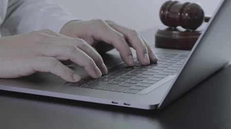 судья : Close up Hand Lawyer working with laptop computer in office Стоковые видеозаписи