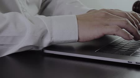 solicitor : Close up Hand Lawyer working with laptop computer in office Stock Footage