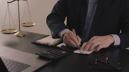 banqueiro : Justice and law concept.Businessman or lawyer in the office working with calculator