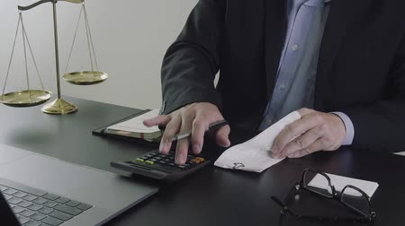 attorney : Justice and law concept.Businessman or lawyer in the office working with calculator
