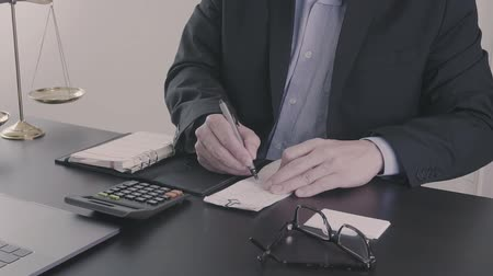 налоги : Justice and law concept.Businessman or lawyer in the office working with calculator