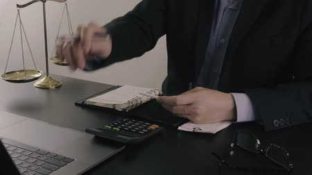 ügyvéd : Justice and law concept.Businessman or lawyer in the office working with calculator