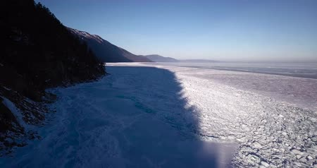 extreme weather : Frozen lake. Deep blue ice, hummocks, cracks Beautiful winter landscape with transparent smooth ice. Stock Footage