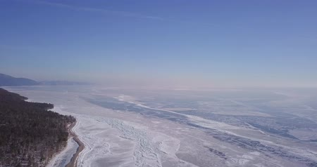 camsı : Frozen lake. Deep blue ice, hummocks, cracks Beautiful winter landscape with transparent smooth ice. Stok Video