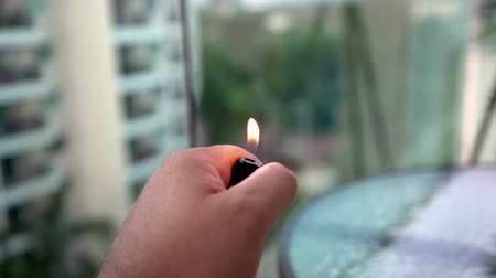 Lighter on the hand, Igniting cigarette lighter.