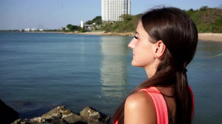 Vacation travel woman relaxing enjoying Amazing view of sea. tourist destination
